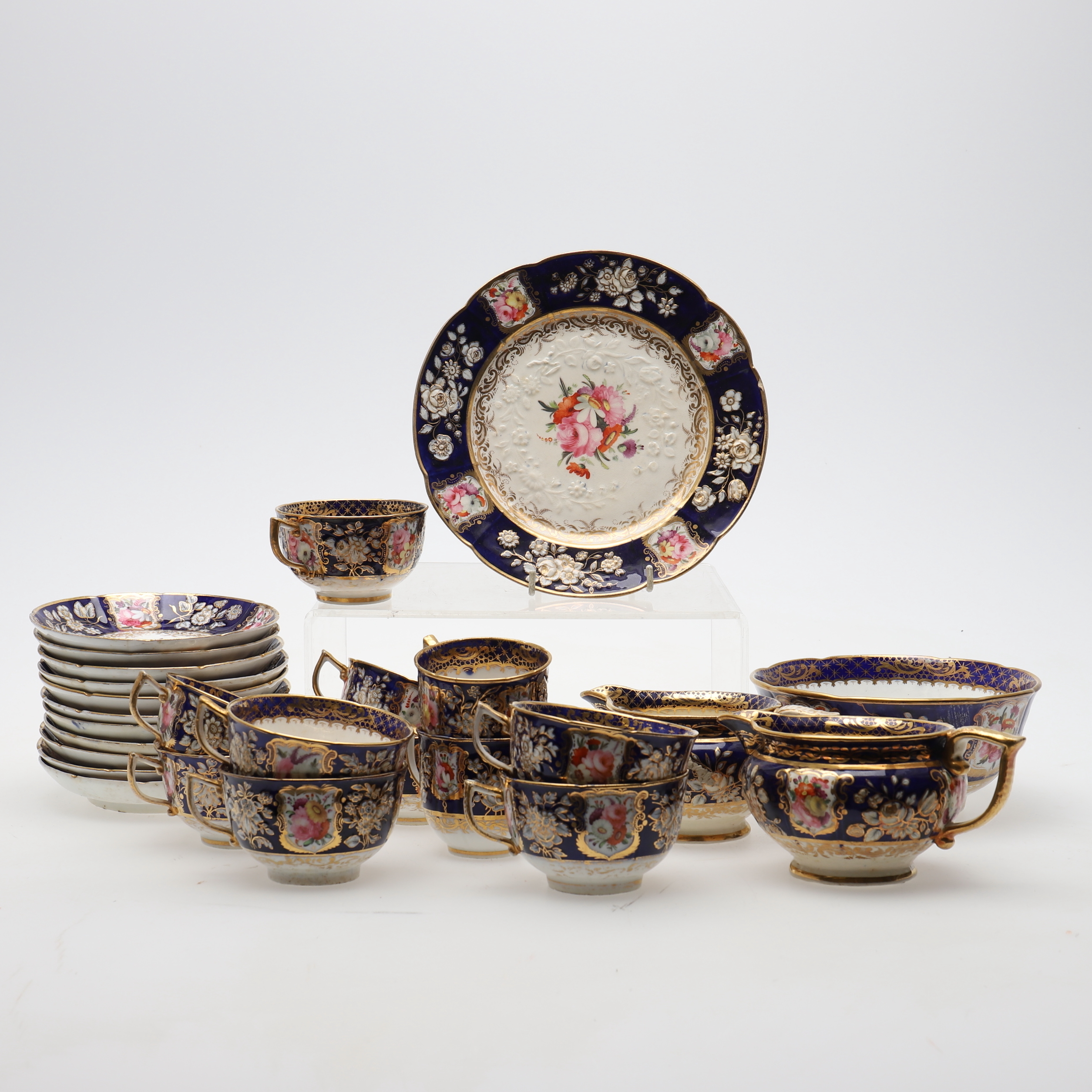 A COALPORT PORCELAIN BLUE GROUND AND GILT PART TEA SERVICE