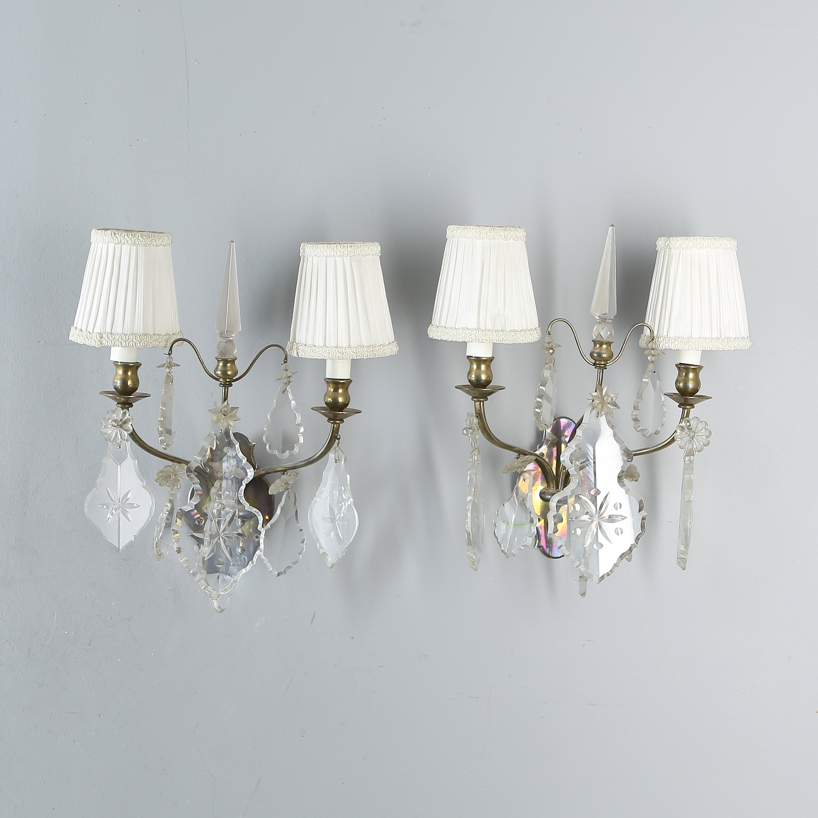 WALL LAMPS, a pair, brass, hung with prisms, first half of
