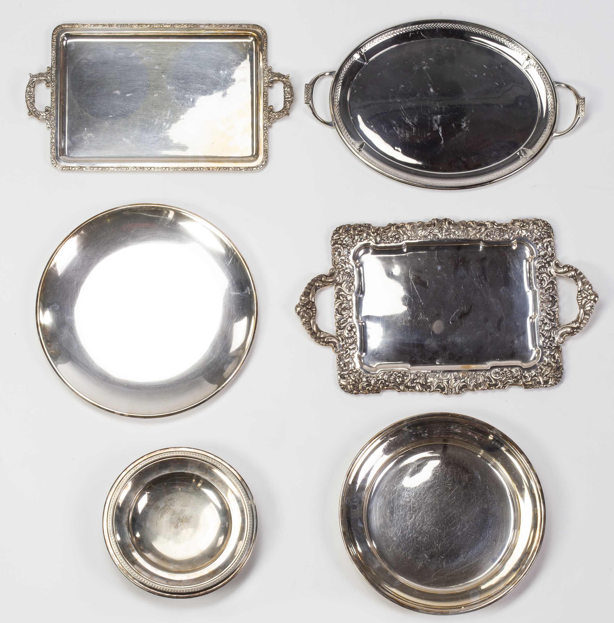 Five trays and a platter in silver-plated metal, second half